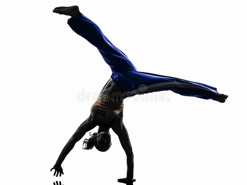 Silhueta da dança do dançarino do capoeira da mulher fotografia de stock