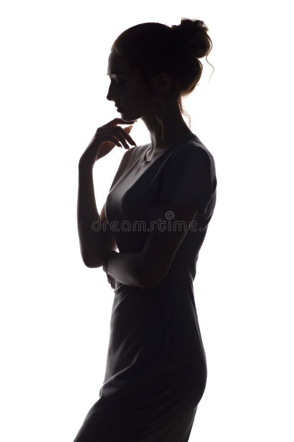 Silhueta da figura da menina bonita, perfil da mulher no fundo isolado branco foto de stock