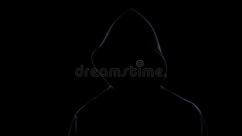 Silhueta da morte isolada no fundo preto, conceito mortal da doença imagem de stock