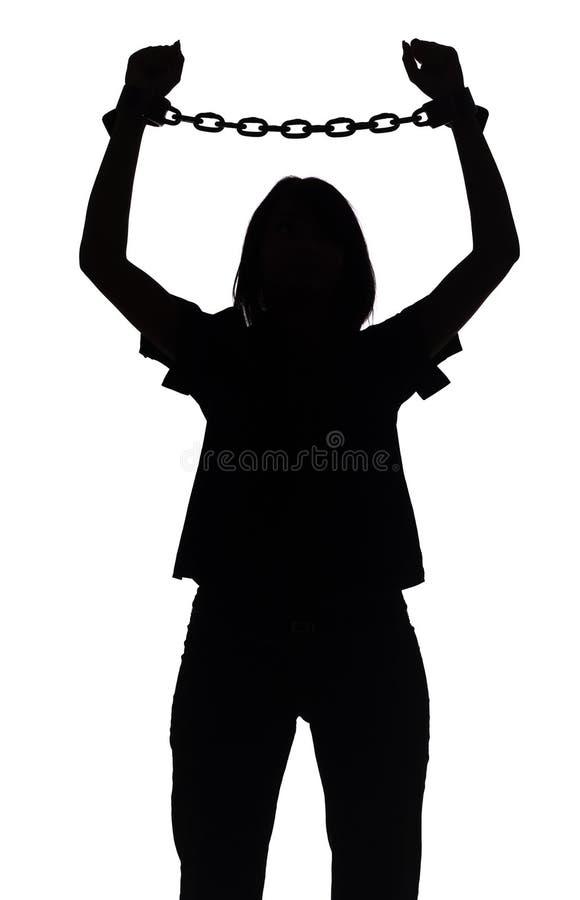Silhueta da mulher com correntes fotos de stock