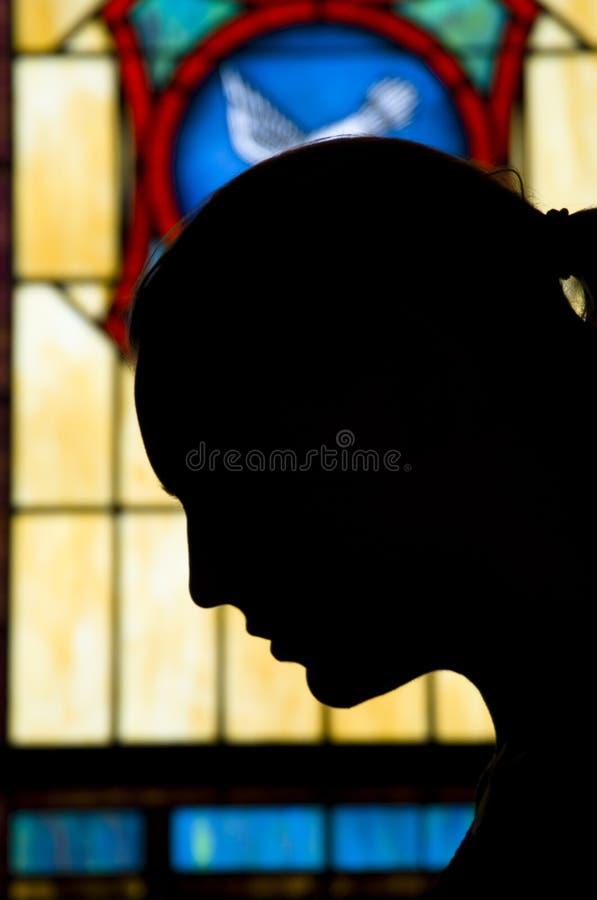 Silhueta da oração fotografia de stock royalty free