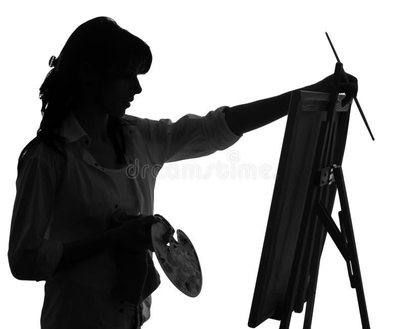 Silhueta da pintura do artista da mulher fotos de stock royalty free