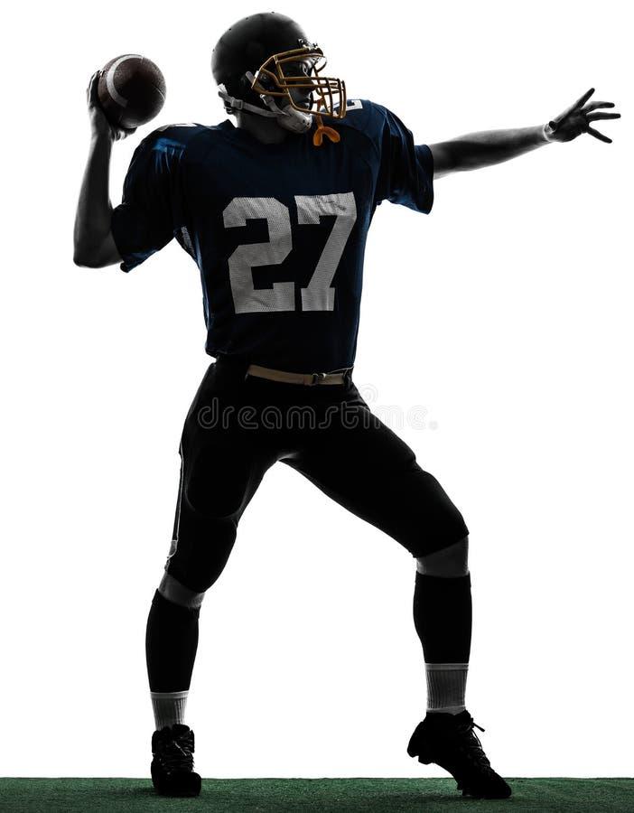 Silhueta de jogo americana do homem do jogador de futebol do lançador fotos de stock