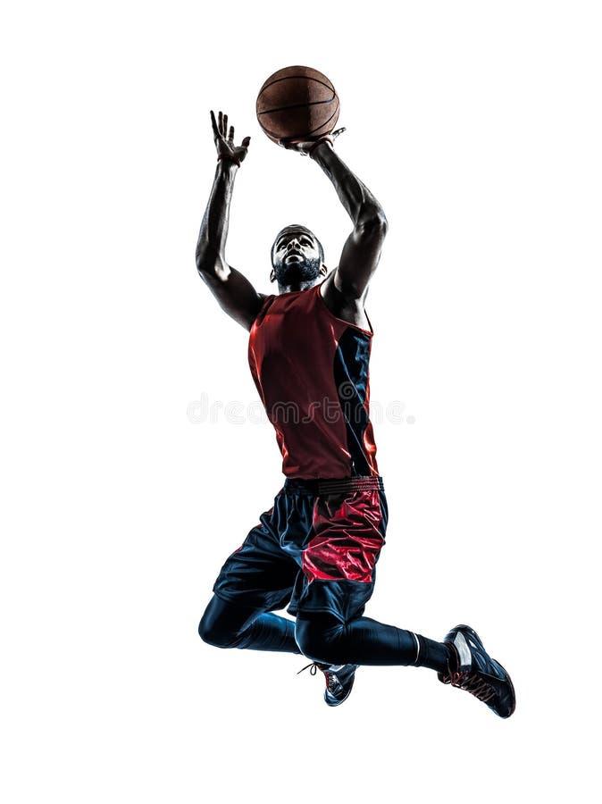 Silhueta de jogo de salto africana do jogador de basquetebol do homem fotos de stock