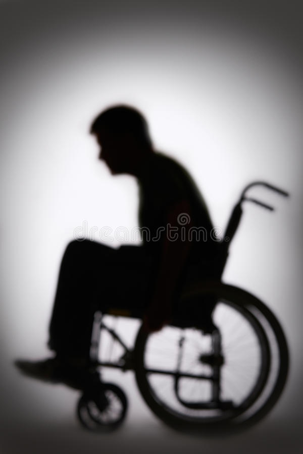 Silhueta de Person In Wheelchair deficiente imagem de stock