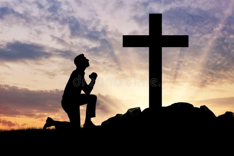 Silhueta de rezar do homem fotografia de stock