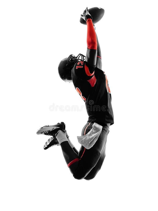 Silhueta de travamento da bola do jogador de futebol americano imagens de stock royalty free