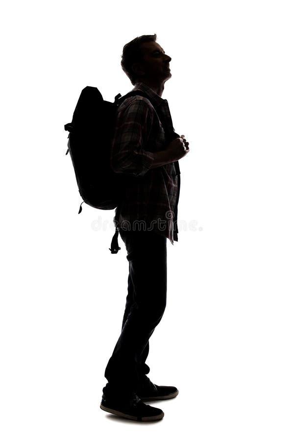 Silhueta de um caminhante ou de um guia tur?stica masculino foto de stock