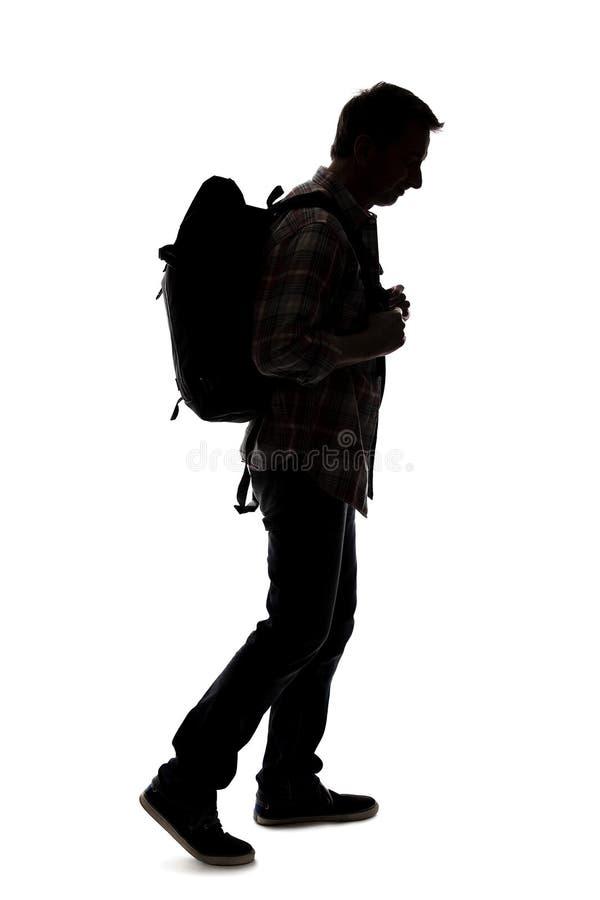 Silhueta de um caminhante ou de um guia tur?stica masculino imagem de stock