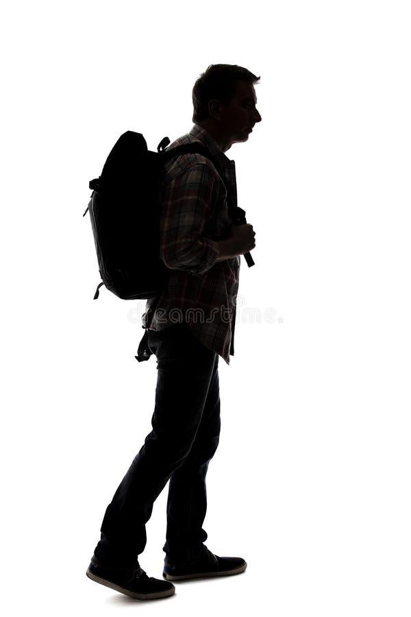 Silhueta de um caminhante ou de um guia tur?stica masculino foto de stock royalty free