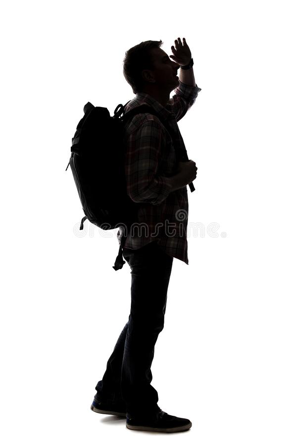 Silhueta de um caminhante ou de um guia tur?stica masculino fotografia de stock