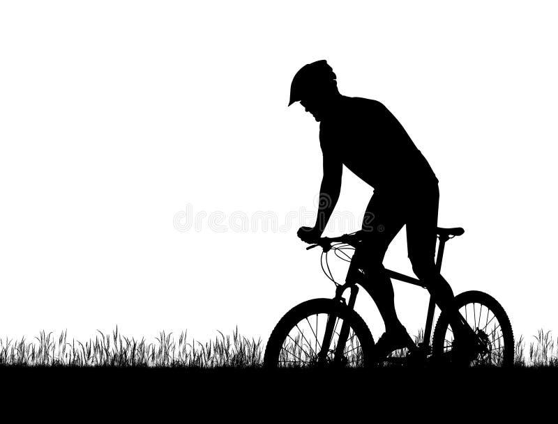 Silhueta de um ciclista em um Mountain bike fotografia de stock royalty free