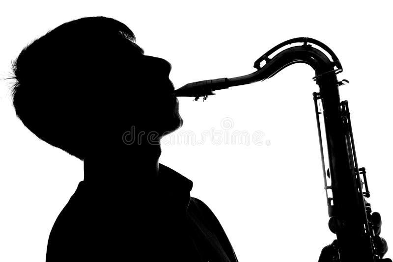 Silhueta de um homem que joga o saxofone ilustração stock