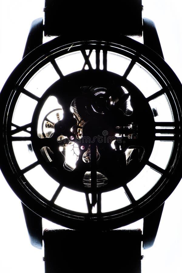 Silhueta de um relógio e de seu bracelete Isolado fotos de stock