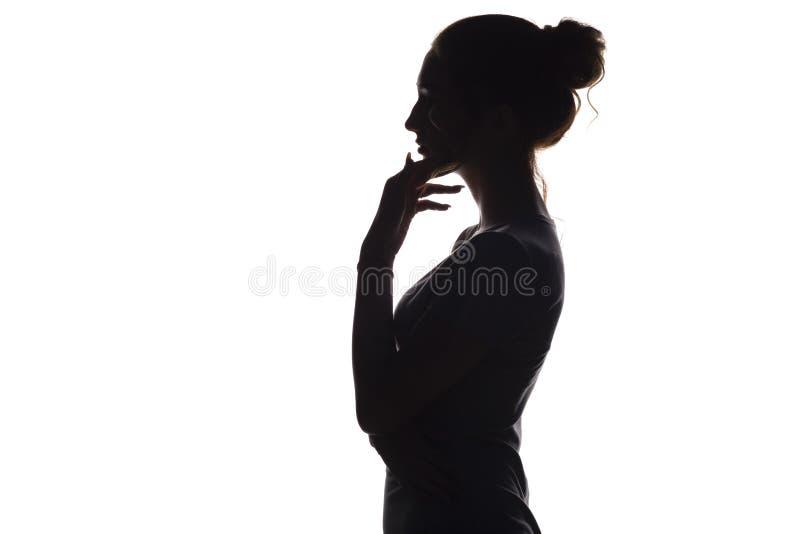 Silhueta de uma mulher com mão perto do queixo, perfil da cara da menina imagem de stock
