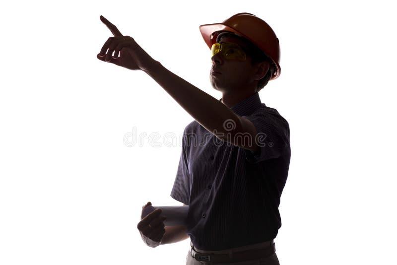 Silhueta do coordenador de construção masculino com o rolo que constrói o PR fotos de stock royalty free