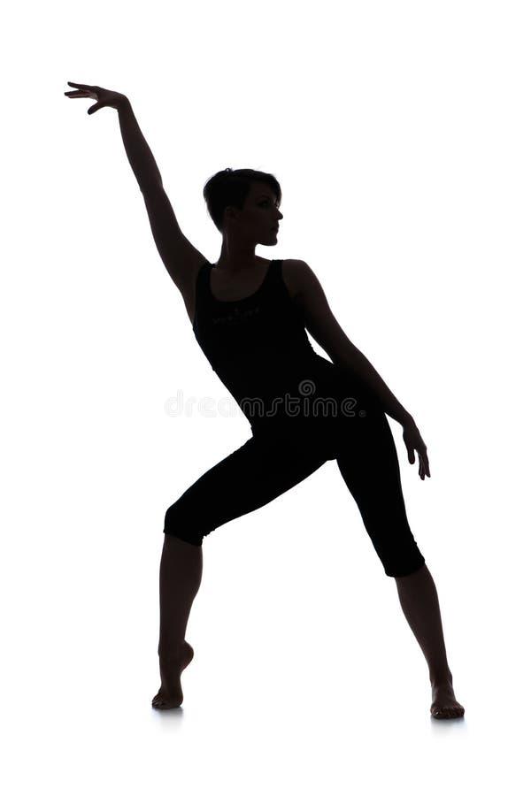 Silhueta do dançarino da mulher foto de stock