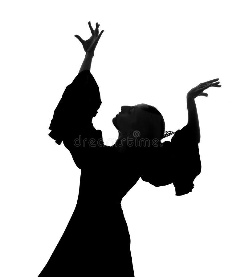 Silhueta do dançarino espanhol do flamenco da mulher que dança Sevillanas imagem de stock