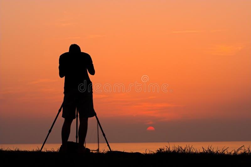 Silhueta do fotógrafo imagens de stock
