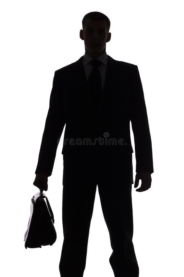 Silhueta do homem com mala de viagem foto de stock royalty free