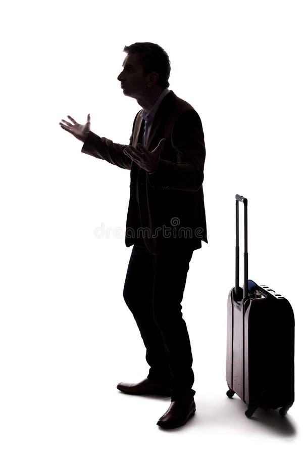 Silhueta do homem de neg?cios de viagem Upset no voo atrasado ou cancelado foto de stock