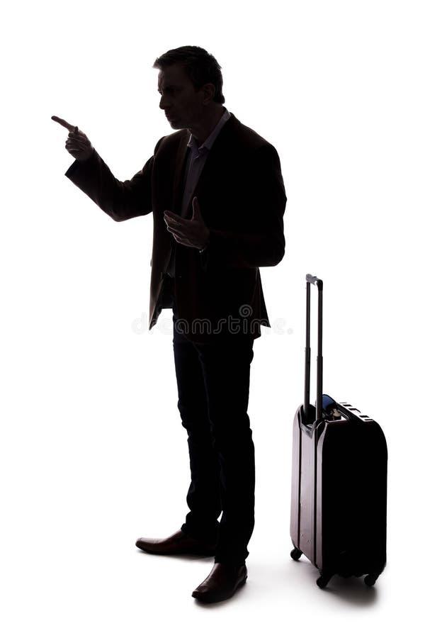 Silhueta do homem de neg?cios de viagem Upset no voo atrasado ou cancelado foto de stock royalty free
