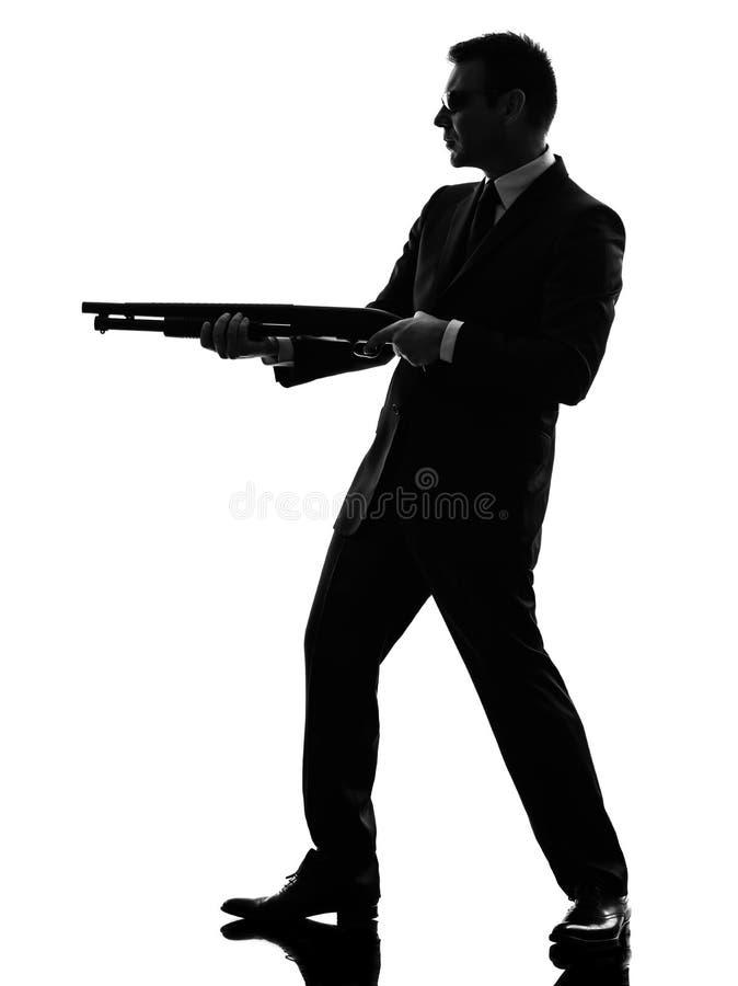 Silhueta do homem do assassino fotos de stock