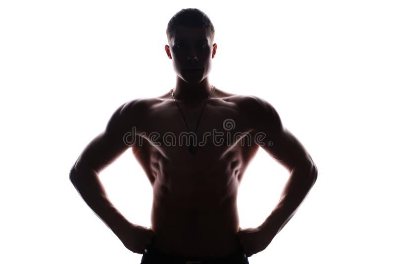 Silhueta do homem novo do halterofilista do atleta imagem de stock