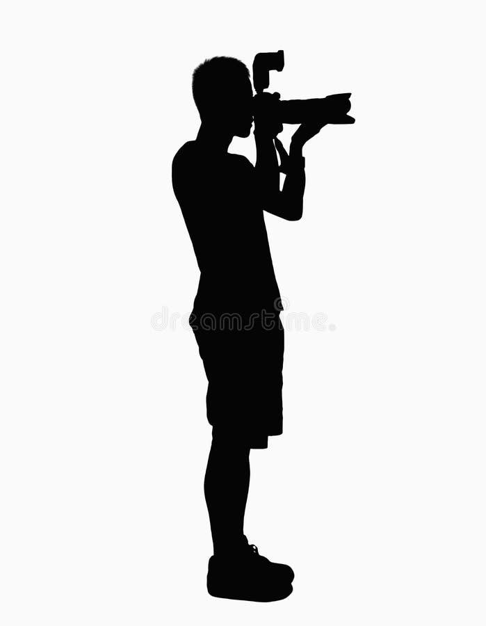 Silhueta do homem que guardara a câmera. fotografia de stock royalty free