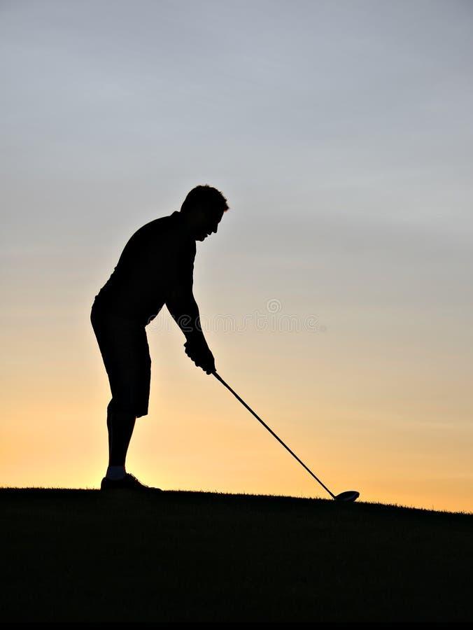 Silhueta do jogador de golfe imagem de stock royalty free