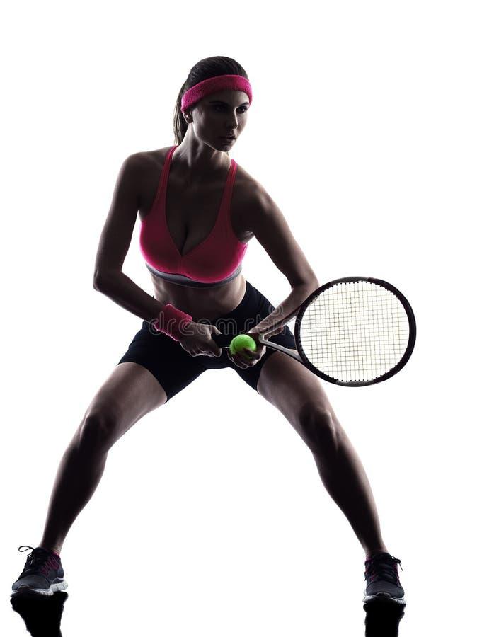 Silhueta do jogador de tênis da mulher fotografia de stock