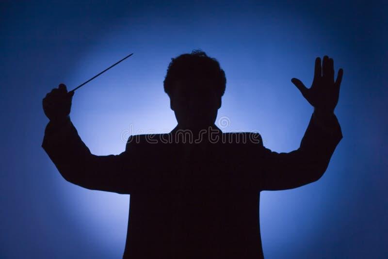 Silhueta Do Maestro Imagens de Stock