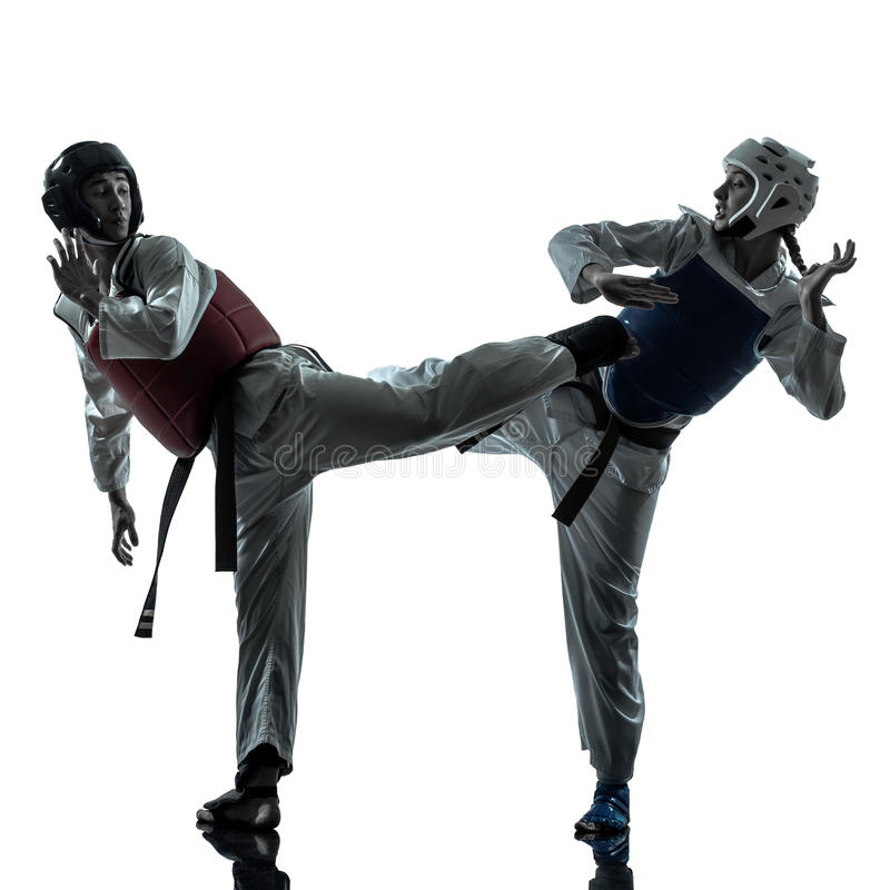 Silhueta dos pares da mulher do homem das artes marciais de taekwondo do karaté imagem de stock royalty free
