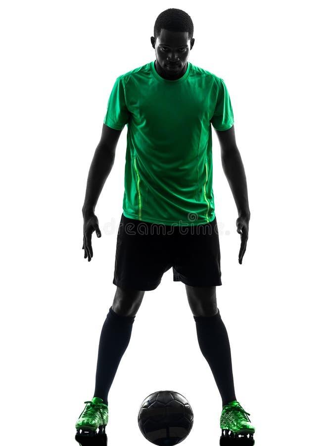 Silhueta ereta africana do jogador de futebol do homem fotos de stock royalty free
