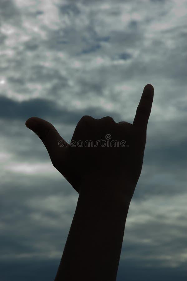 Silhueta havaiana do sinal de Shaka imagem de stock