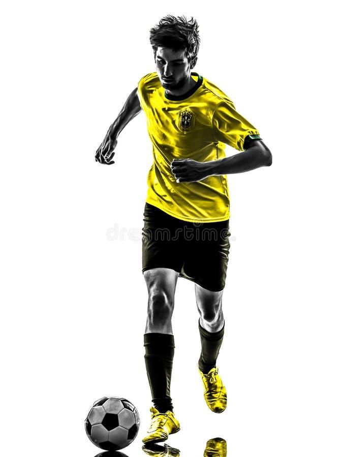 Silhueta running brasileira do homem novo de jogador de futebol do futebol fotos de stock