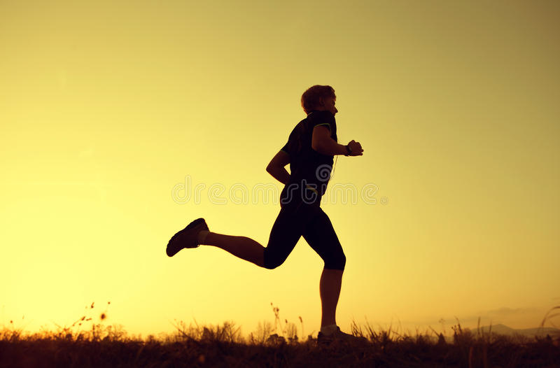 Silhueta Running do homem fotos de stock royalty free