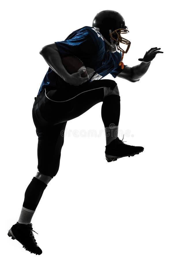 Silhueta running do homem do jogador de futebol americano fotos de stock royalty free