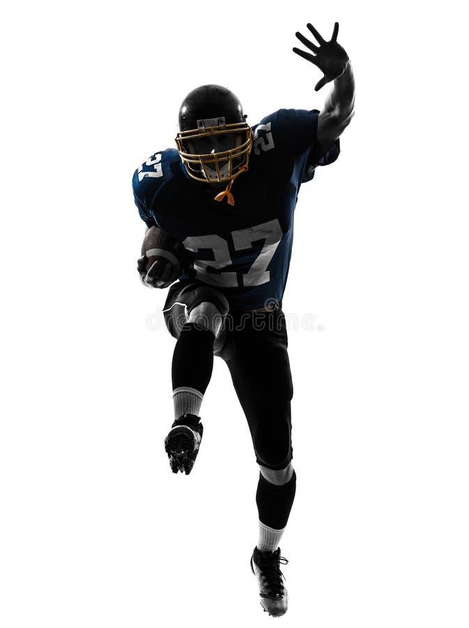 Silhueta running do homem do jogador de futebol americano fotografia de stock royalty free