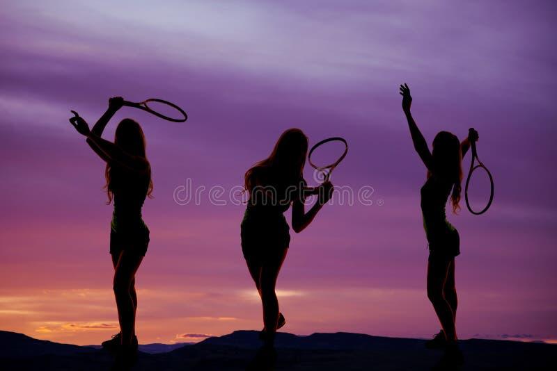 Silhueta três do tênis da mulher fotos de stock
