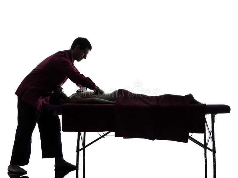 Silhueta traseira da terapia da massagem imagens de stock royalty free