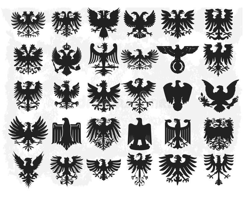 Silhuetas de águias heráldicas ilustração royalty free