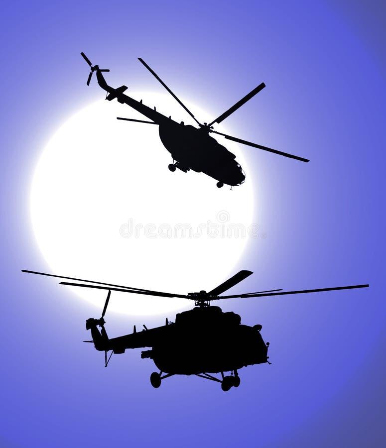 Silhuetas dos helicópteros na noite ilustração royalty free