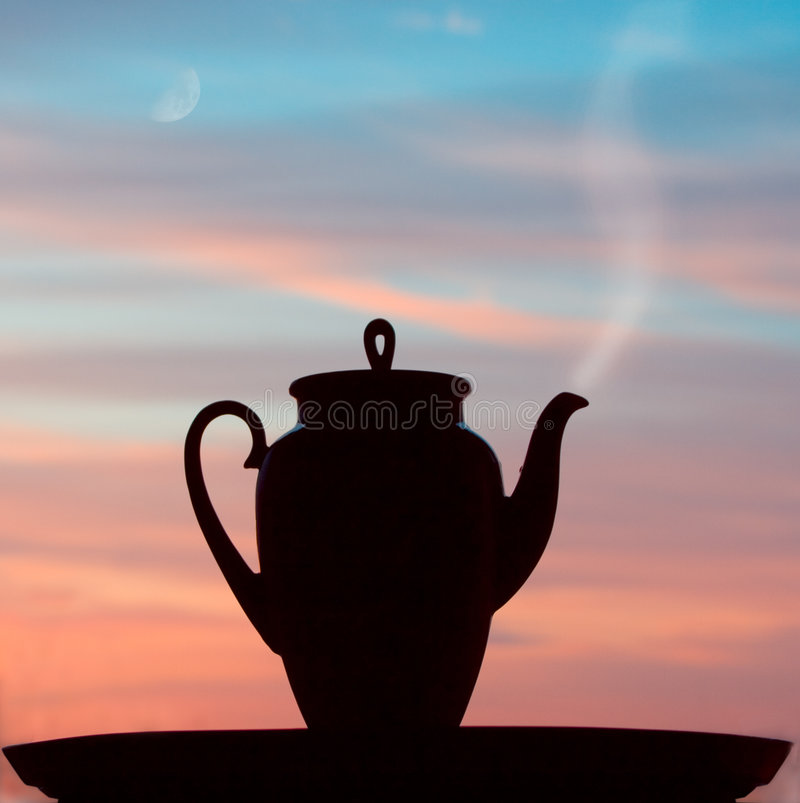 Silhuette teapot in the sunrise royalty free stock photo