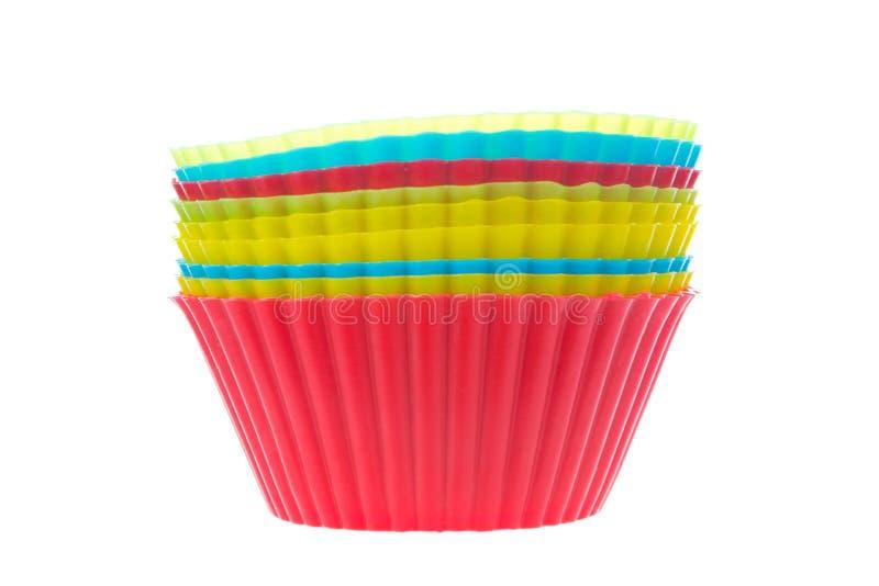 Siliciumvormen voor eigengemaakte cupcakes stock afbeelding