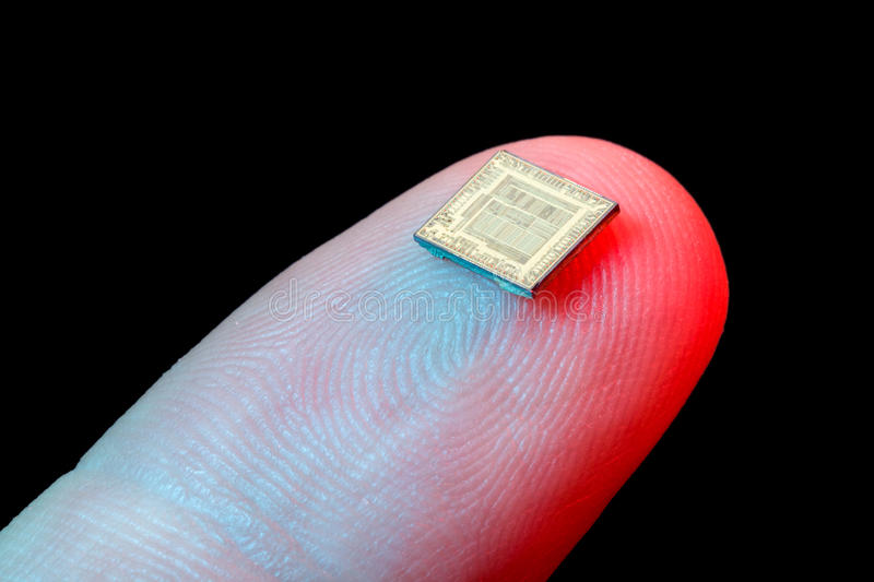 Silicon microchip on fingertip royalty free stock image