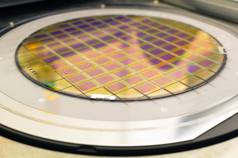 Silicon wafer with microchips fixed in the holder is on the chuck and ready for process cleaning stock image
