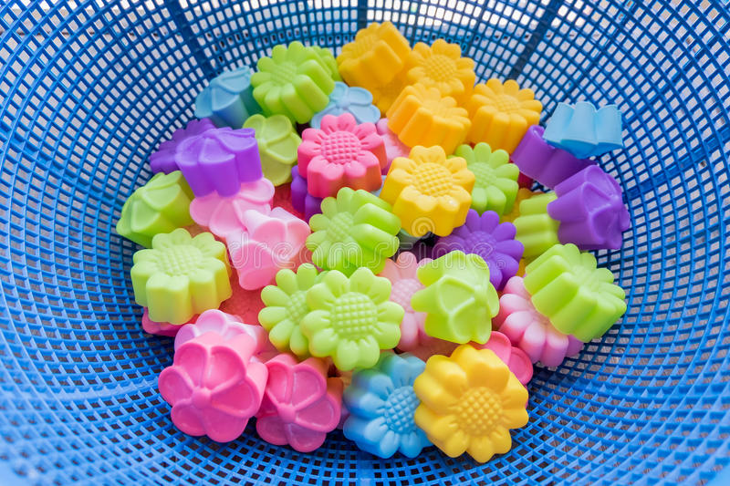 Silicone baking molds. Colorful flowers stock images
