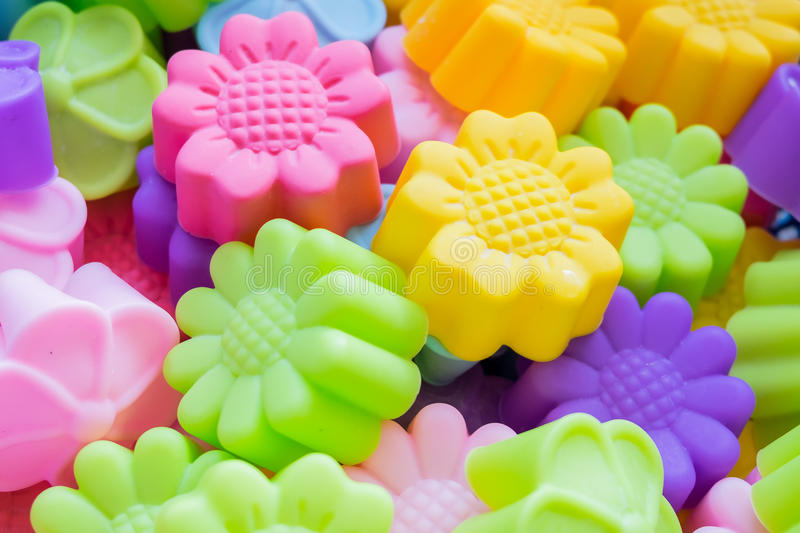 Silicone baking molds. Colorful flowers stock photos