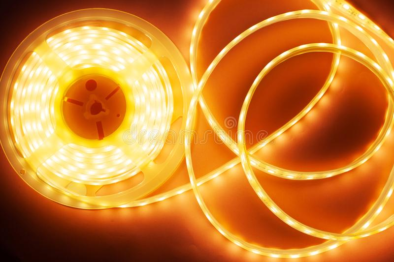 Silicone diode tape for lighting decorative corners and niches, LED light coil. Close-up stock images